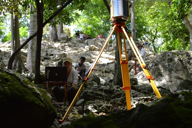 Here the geodetic GLS-1500 scanning crew captures rough terrain with the assistance of an interested local.