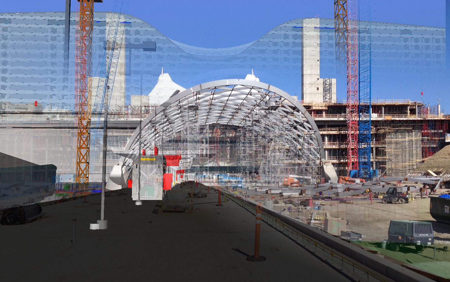 With the concrete for the platform in place, this model/photo composite provides context for the completed structure. Note that the stairwells provide a reference point for the completed height. This vantage point is also where the first few minutes of the accompanying video were shot. Credit: William Lineberry, Design Technology Manager, HNTB