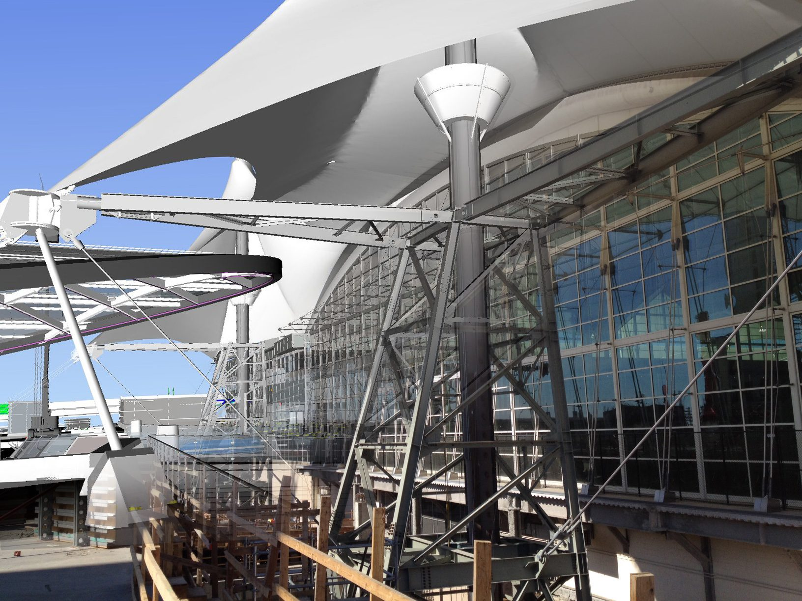 Maintaining the anchoring for the white tension fabric roof provided a challenge in the early planning and design stages. This photo/model composite shows the detail of the temporary grounding tower, and a window into the final support structure at this dramatic entry point to the main terminal. Credit: William Lineberry, Design Technology Manager, HNTB.