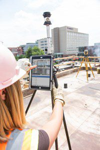 In this photo, Autodesk BIM 360 Layout is being used in the field with the iPad mounted to a pole that connects to Topcon's Ln-100 Total Station for precise coordination between the model and the construction reality. Photo courtesy of PCL Construction.
