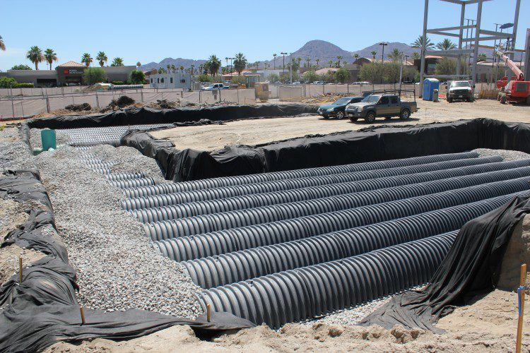 The full field of chambers, with a layer of geosynthetic fabric to keep out sediment, is ready for backfill.