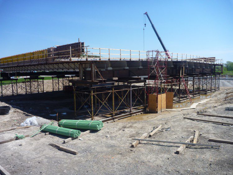 Bridge superstructures were constructed on temporary shoring towers in staging areas near the interchange.