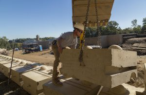 One-ton Redi-Rock blocks interlock and are assembled by crane— construction times are short compared to most retaining wall structures.